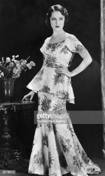 Promotional still of Canadianborn actor Fay Wray wearing a floorlength floral dress 1930s