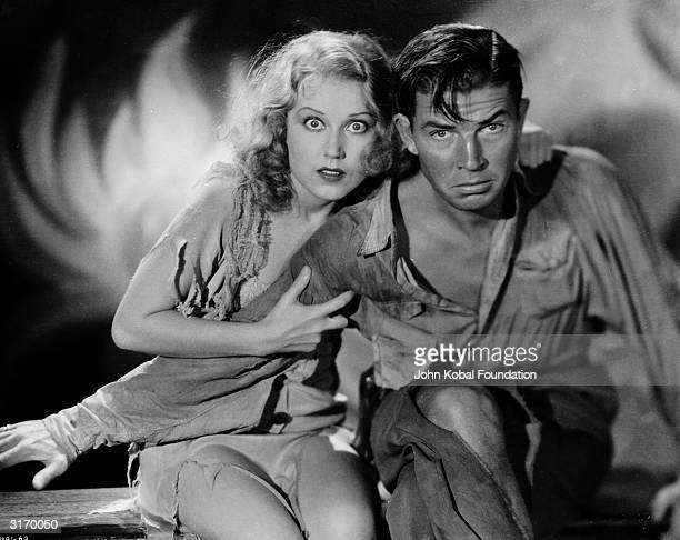 Promotional still of Fay Wray clutching the arm of Bruce Cabot from the film 'King Kong' directed by Merian Cooper and Ernest Schoesdeck 1933