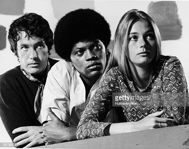 Promotional studio portrait of actors Michael Cole , Clarence Williams III and Peggy Lipton for the television series, 'The Mod Squad,' c. 1968.