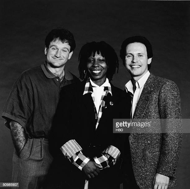 Promotional studio portrait of American comedians and Robin Williams Whoopi Goldberg and Billy Crystal the hosts of the 'Comedy Relief' variety...
