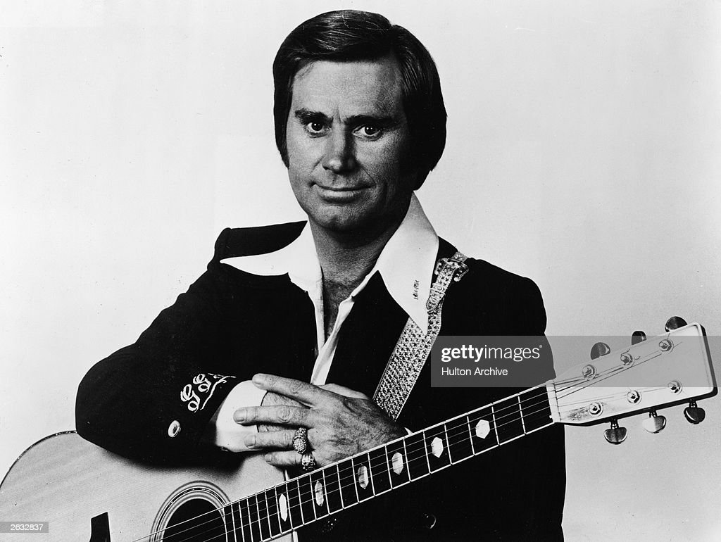 Portrait Of George Jones With Guitar : News Photo