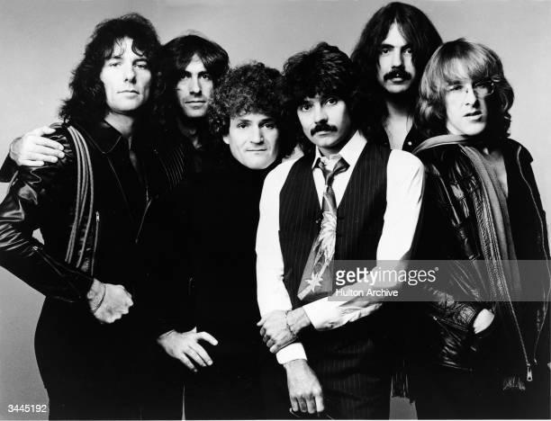 Promotional studio portrait of American rock group Jefferson Starship 1970s LR Aynsley Dunbar Pete Sears David Freiberg Mickey Thomas Craig Chaquico...