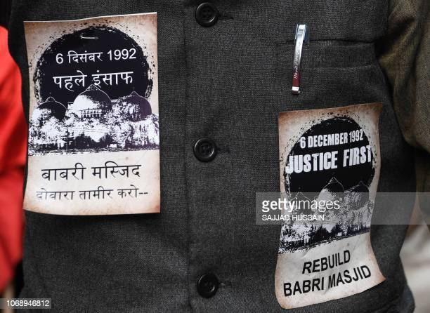 A proMuslim activist is seen with stickers pasted on his jacket on the 26th anniversary of the demolition of the 16th century Babri Masjid located in...