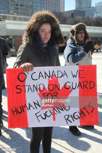 Pro-Muslim demonstrators hold a counter-protest against anti-Muslim groups over the M-103 motion to fight Islamophobia in downtown Toronto, Ontario,...