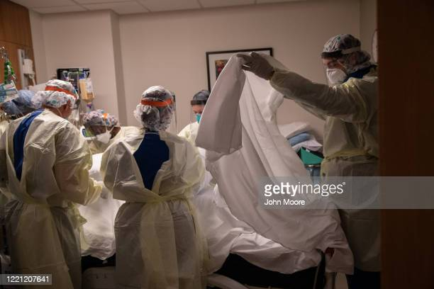 "Prone team,"" wearing personal protective equipment , turns over a patient with COVID-19 in a Stamford Hospital intensive care unit , on April 24,..."
