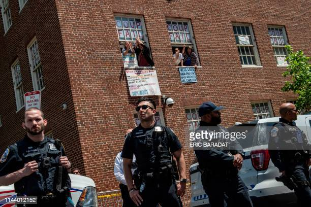 ProNicolas Maduro supporters and activists occupying the Venezuelan embassy in Washington waves from a window to Reverend Jesse Jackson who came to...