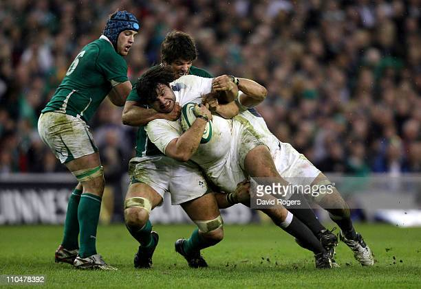 Prop Alex Corbisiero of England is hauled to the ground by Donncha O'Callaghan of Ireland during the RBS 6 Nations Championship match between Ireland...