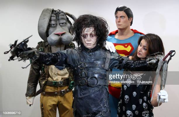 Prop Store employee adjusts the costume of Edward Scissorhands on display next to Christopher Reeve's Superman costume and Michael Jackson's 'Spike'...