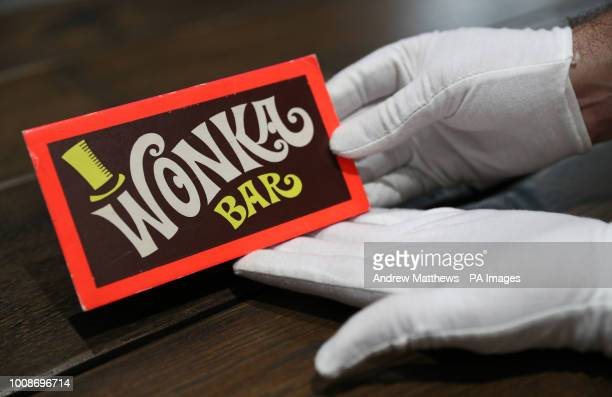 A Prop Store employee holds a Wonka Bar from the film Willy Wonka amp the Chocolate Factory in the Prop Store head office near Rickmansworth ahead of...