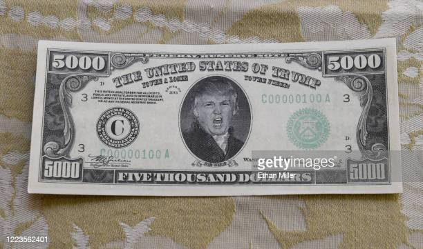 A prop USD 5000 bill is displayed in the makeup room of actor comedian and writer John Di Domenico as he gets ready to record videos as US President...