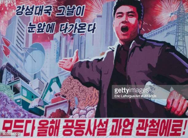 Propaganda billboard about economic development Pyongan Province Pyongyang North Korea on April 26 2010 in Pyongyang North Korea