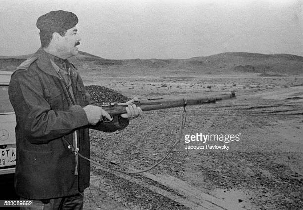 Propaganda photograph of the Raïs shooting with a rifle during the IranIraq war