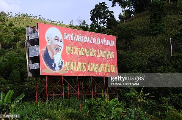 A propaganda poster appealing to people to follow late president Ho Chi Minh's moral values is seen on the flank of a hill in the northern...