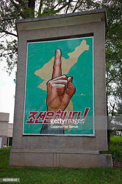 CONTENT] Propaganda poster at the gate of the DMZ in North Korea The poster claims that Koryo is one meaning Korea is one country