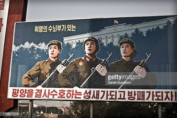 Propaganda poster depicting soldiers of the Korean Peoples Army at arms. Found in Pyongyang, North Korea.