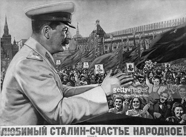 A propaganda poster depicting Soviet Premier Joseph Stalin applauding an adoring crowd in Red Square Moscow 1949 The caption reads 'Beloved Stalin...