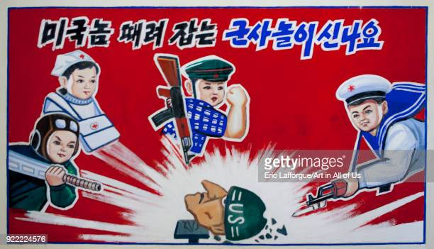 Propaganda poster in a primary school depicting North Korean soldiers killing an american soldier South Pyongan Province Chongsanri Cooperative Farm...