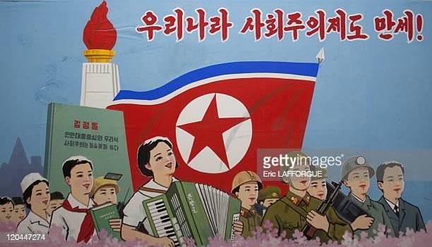 Propaganda poster in a school in North Korea on May 20, 2009.