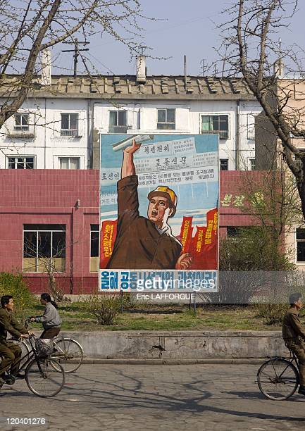 Propaganda Poster in North Korea It says Let's accomplish this year's tasks Strengthening Political ideology Highest priority on improving people's...
