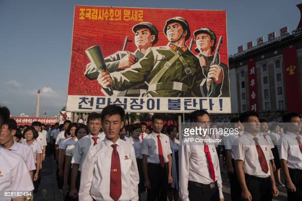 TOPSHOT A propaganda poster is displayed during a rally in support of North Korea's stance against the US on Kim IlSung square in Pyongyang on August...