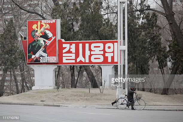 Propaganda poster is seen on April 3 2011 in Pyongyang North Korea Pyongyang is the capital city of North Korea and the population is about 2000