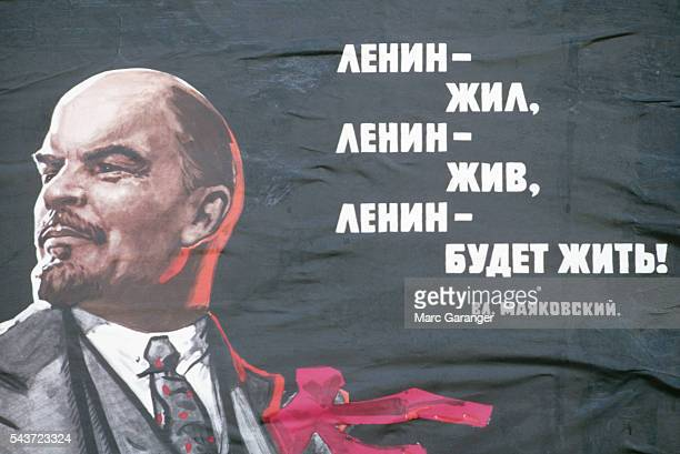 A propaganda poster of Lenin showing the words Lenin lived Lenin is living Lenin will live