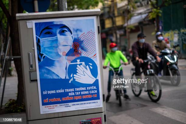 Propaganda poster reminding people to take self-protection during the Coronavirus pandemic can bee seen on Hang Bong street on April 1, 2020 in...