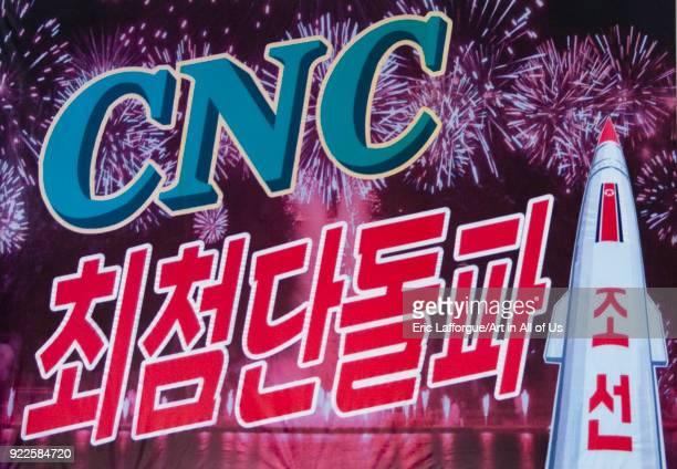 Propaganda poster with a missile and the computer numerical control program, Pyongan Province, Pyongyang, North Korea on April 26, 2010 in Pyongyang,...