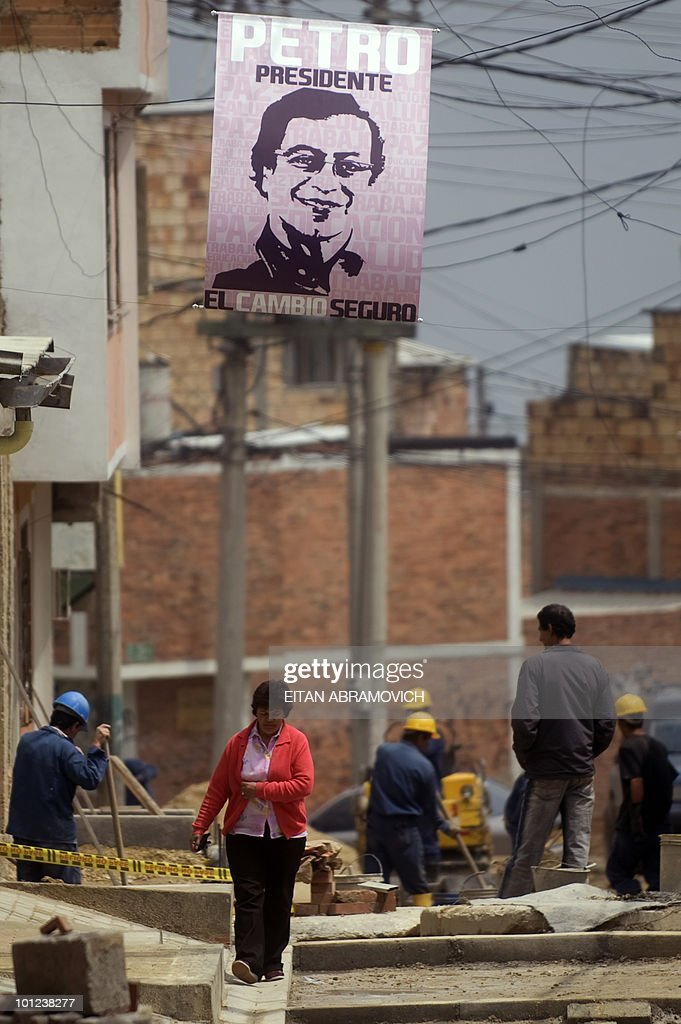 A propaganda sign of Colombian presidential candidate for the leftist Alternative Democratic Pole Party, Gustavo Petro, hangs in an alley in the outskirts of Bogota on May 28, 2010. Colombia will hold presidential elections next May 30, and according to polls, a run-off election between the presidential candidate for the Green Party, Antanas Mockus, and the presidential candidate for the ruling National Unity Party, Juan Manuel Santos, will take place on June 20. AFP PHOTO/Eitan Abramovich