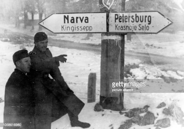 Propaganda text on the back of the picture for National Socialist report Narva and Kingissepp lie behind us The sign towards Petersburg shows us the...