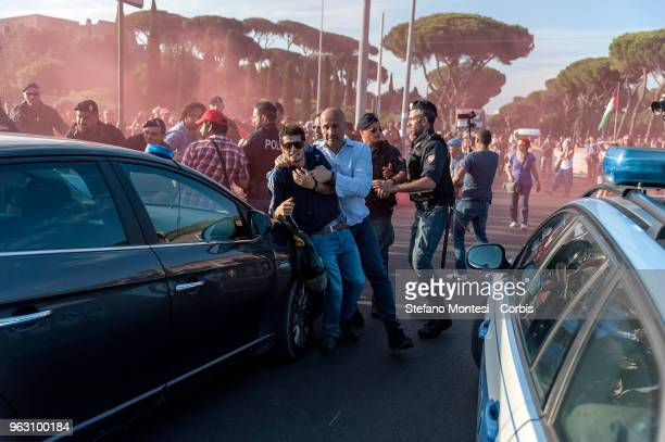 ProPalestine activists stopped by the police during the protests against the Tour of Italy cycling race following its inital desparture from...