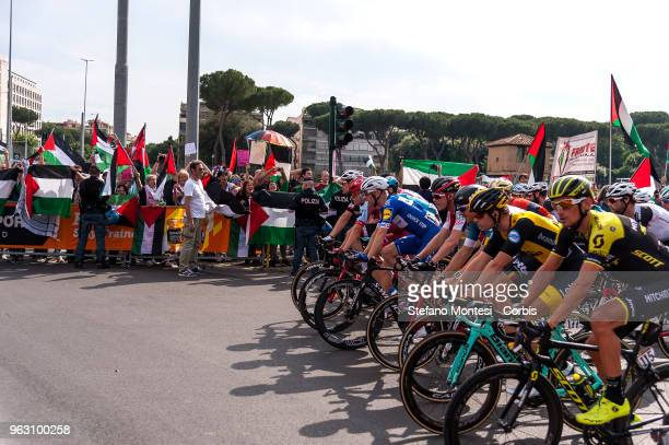 ProPalestine activists waving Palestinian flags at the passage of cyclists demonstrating at the Tour of Italy cycling race which began in Israel on...