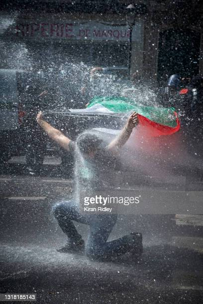 Pro-Palestine Protestor gets hit by police water canon as police try to break up a demonstration in solidarity with Palestine, after the recent...