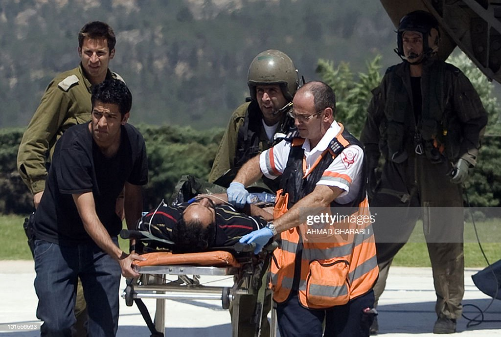 A pro-Palestinian activist is evacuated to Hadassah Ein Kerem Hospital in Jerusalem after Israeli navy seals stormed a boat carrying humanitarian aid to the Gaza Strip against an Israeli blockade, in a raid which killed at least 10 passengers on May 31, 2010.