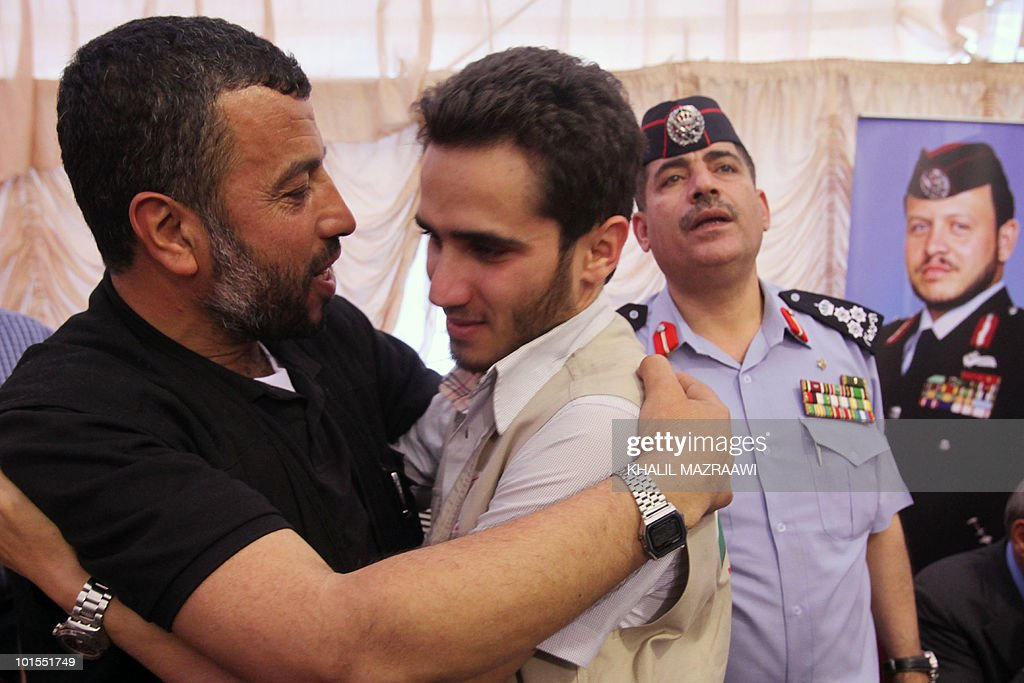A pro-Palestinian activist, seized during a raid on an aid convoy sailing to Gaza, is hugged by a relative following his arrival in Jordan, after crossing the Allenby Bridge crossing point between Israel and Jordan, on June 2, 2010 as Israel began expelling the detained activists.