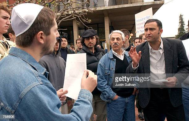 ProPalestinian demonstrator Amin Miraftab argues with proIsraeli demonstrator Alexander Bilinskey April 9 2002 during a protest on the University of...