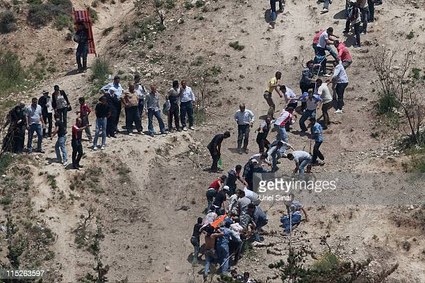 A proPalestinian demonstrator is helped after being shot at by Israeli troops as seen from the Druze village of Majdal Shams on June 5 2011 in Israel...