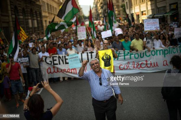 ProPalestinian demonstrators shout antiIsrael slogans during a demonstration on July 17 2014 in Barcelona Spain Earlier in the day Israel agreed to a...