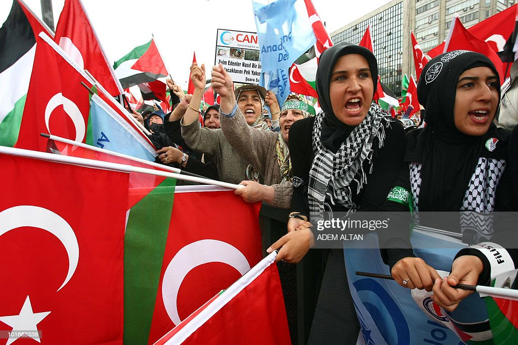 Pro-Palestinian demonstrators wave Turkish and Palestinian flags during a protest in Ankara on June 6, 2010 against Israel's deadly raid on Gaza-bound aid ship. Turkey's Prime Minister Recep Tayyip Erdogan vowed to hold Israel to account over its 'state terror' in the Middle East as thousands held fresh protests against the Israeli operation, in which nine Turks were killed.