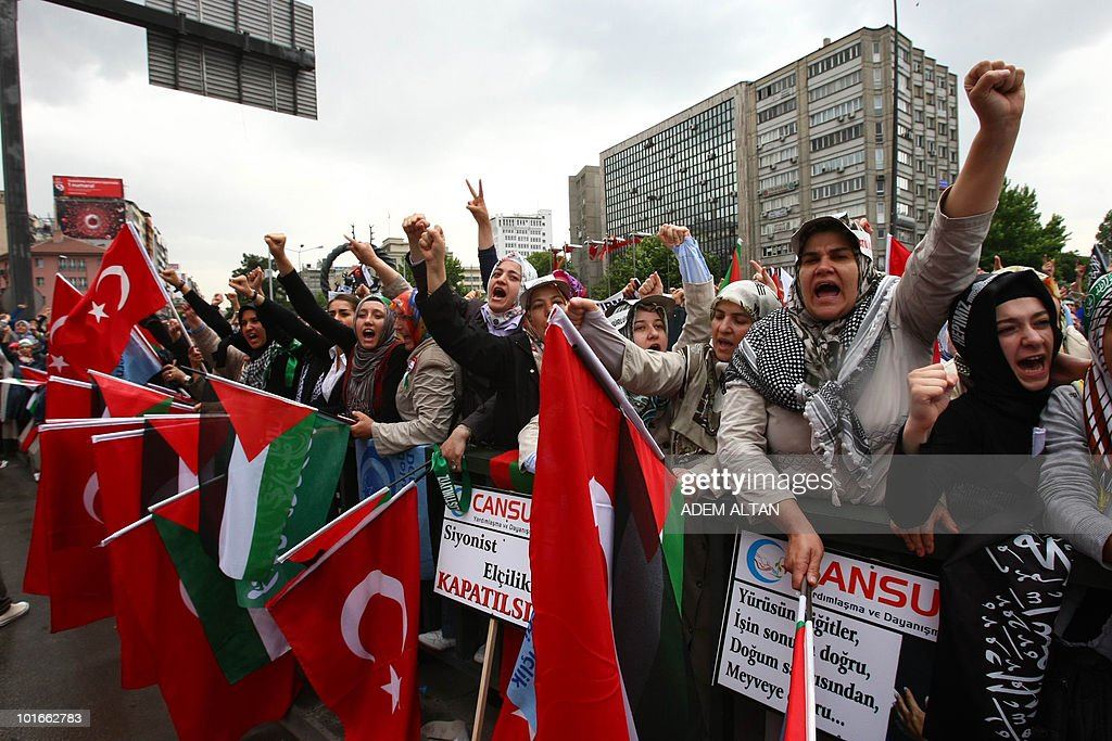 Pro-Palestinian demonstrators wave Turkish and Palestinian flags during a protest in Ankara on June 6, 2010 against Israel's deadly raid on Gaza-bound aid ship. Some 6,000 to 7,000 people gathered under pouring rain in a central square, several kilometres away from the government buildings and parliament. Turkey's Prime Minister Recep Tayyip Erdogan vowed to hold Israel to account over its 'state terror' in the Middle East as thousands held fresh protests against the Israeli operation, in which nine Turks were killed.