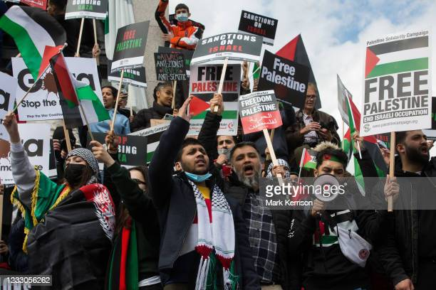 Pro-Palestinian protesters gather around Nelson's column in Trafalgar Square during the National Demonstration for Palestine on 22nd May 2021 in...