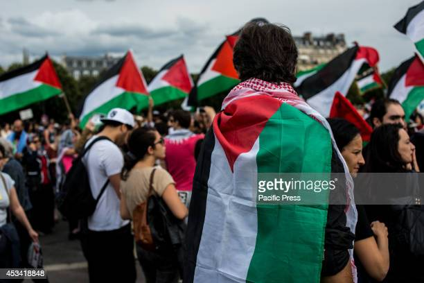 Propalestinian supporters during a demonstration in the street of Paris Thousands of people marched shouting slogans against Israel and for the...