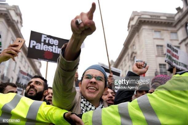 ProPalestinian supporters join national march through central London England on November 4 2017 as they demand justice and equal rights for...