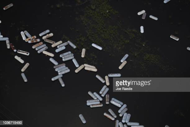 Propane tanks are seen in the flood waters after heavy rains from Hurricane Florence inundated the area on September 20 2018 in Lumberton North...