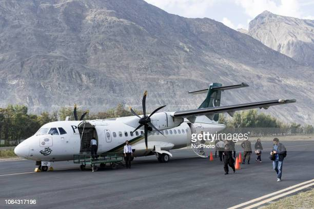 Propeller airliner from PIA airline, Pakistan International Airline, on the Gilgit airport runway.
