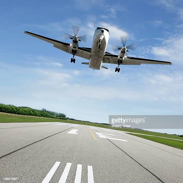 XL propeller airplane landing on runway