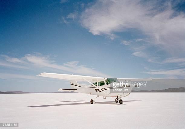 Propeller airplane on salt flat