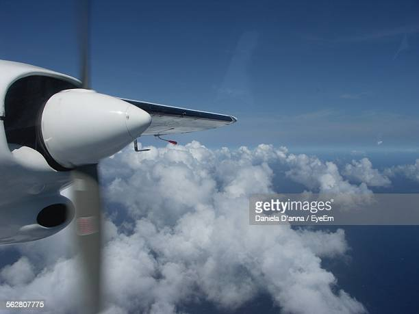 Propeller Of Aircraft Flying Over Cloudscape