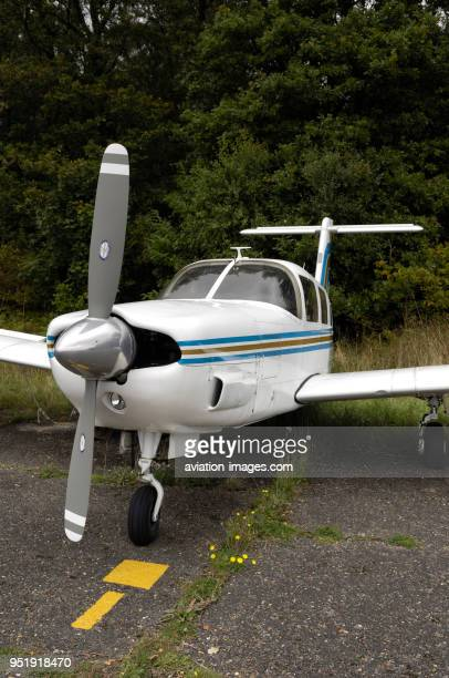 Propellers and nosewheel undercarriage of Piper PA32RT300T Cherokee Lance II parked on the grass
