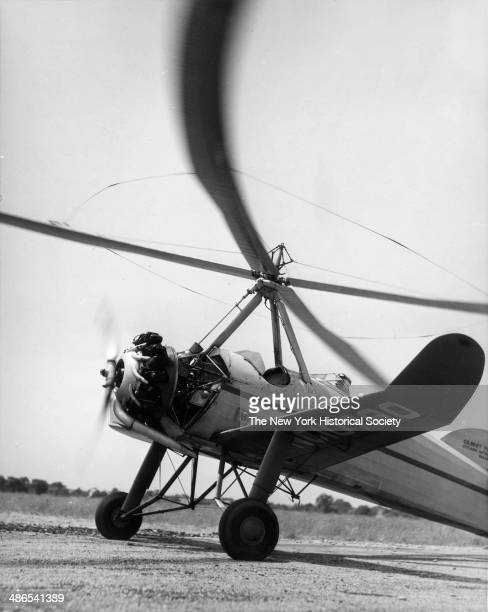 Propellers for an autogyro airplane spin as it readies for flight New York 1930